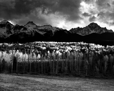 """Mt. Sneffels and turning aspens along County Road 5 near Ridgway, Colorado.  My brother called this an """"inverse sunset"""", with strong light on the foreground and the background in shadow."""