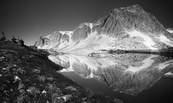 The Snowy Range reflected in Lookout Lake, in southern Wyoming