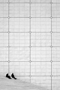 Siiting at the Grande Arche - La Défense Paris
