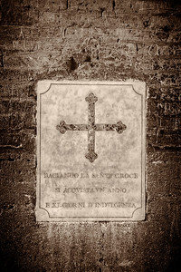 A wall plaque on the coliseum wall in Rome Italy.