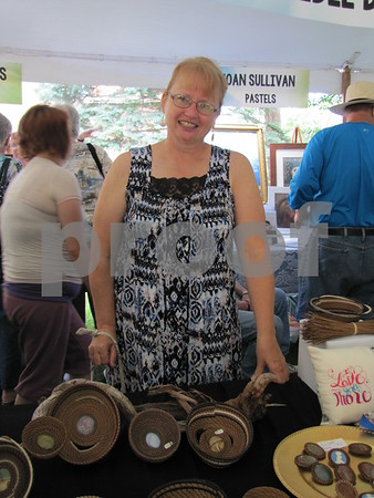 Artist Delayne Segar and a display of her creative pine needle baskets.  Her pieces are also available in the Blanden gift shop.