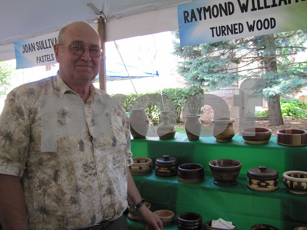 Artist Raymond Williams with his turned wood creations.