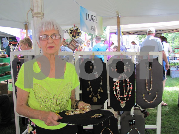 Laurel Mors with her jewelry displayed behind her.