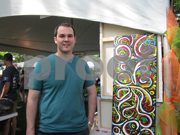 Artist Ryan Knipp with one of his works.