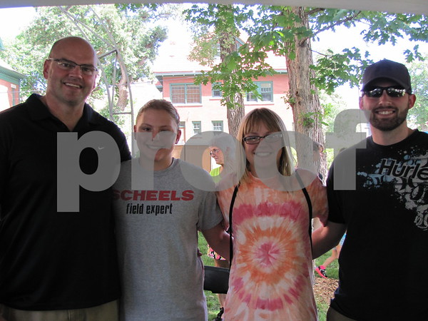 Jeff, Sophie, Gabbie, and Spencer Herzberg pose while browsing through the artist's tents.