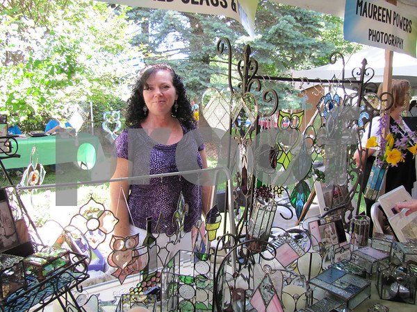 Artist Deb Casey and her stained glass creations.