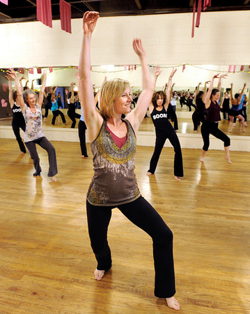 """Co-artistic director Linzee Klinkenberg, center, practices her moves with the group on Wednesday, April 11, during a """"Boom"""" dance rehearsal at Alchemy of Movement dance studio on 30th Street in Boulder. For a video about the dance performance go to  <a href=""""http://www.dailycamera.com"""">http://www.dailycamera.com</a><br /> Jeremy Papasso/ Camera"""