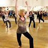 "Co-artistic director Linzee Klinkenberg, center, practices her moves with the group on Wednesday, April 11, during a ""Boom"" dance rehearsal at Alchemy of Movement dance studio on 30th Street in Boulder. For a video about the dance performance go to  <a href=""http://www.dailycamera.com"">http://www.dailycamera.com</a><br /> Jeremy Papasso/ Camera"