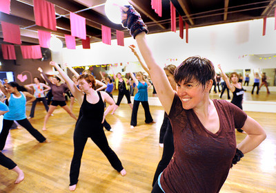 "Chris Harris, of Denver, right, practices her routine with the rest of the ""Boom"" group on Wednesday, April 11, during a ""Boom"" dance rehearsal at Alchemy of Movement dance studio on 30th Street in Boulder. For a video about the dance performance go to www.dailycamera.com Jeremy Papasso/ Camera"