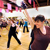 "Chris Harris, of Denver, right, practices her routine with the rest of the ""Boom"" group on Wednesday, April 11, during a ""Boom"" dance rehearsal at Alchemy of Movement dance studio on 30th Street in Boulder. For a video about the dance performance go to  <a href=""http://www.dailycamera.com"">http://www.dailycamera.com</a><br /> Jeremy Papasso/ Camera"