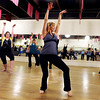 "Kelly Athey, center, Katie Taylor, yellow shirt, and Deborah Malden, left, practice their moves with the rest of the ""Boom"" group on Wednesday, April 11, during a ""Boom"" dance rehearsal at Alchemy of Movement dance studio on 30th Street in Boulder. For a video about the dance performance go to  <a href=""http://www.dailycamera.com"">http://www.dailycamera.com</a><br /> Jeremy Papasso/ Camera"