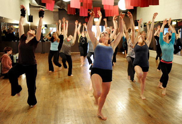 "Laura Jaffe, center, practices her moves with the rest of the ""Boom"" group on Wednesday, April 11, during a ""Boom"" dance rehearsal at Alchemy of Movement dance studio on 30th Street in Boulder. For a video about the dance performance go to  <a href=""http://www.dailycamera.com"">http://www.dailycamera.com</a><br /> Jeremy Papasso/ Camera"