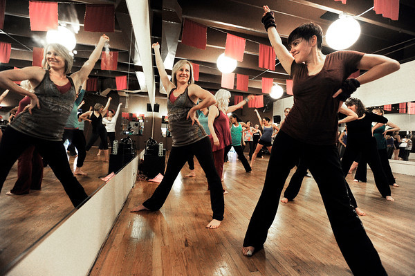 "Co-artistic director Linzee Klinkenberg, left, and Chris Harris, right, smile as they practice their dance moves on Wednesday, April 11, during a ""Boom"" dance rehearsal at Alchemy of Movement dance studio on 30th Street in Boulder. For a video about the dance performance go to  <a href=""http://www.dailycamera.com"">http://www.dailycamera.com</a><br /> Jeremy Papasso/ Camera"