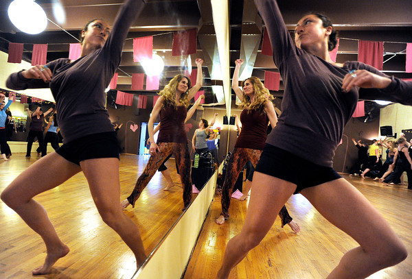 "Laura Jaffe, front, and Susan Newkumet practice their routine while next to the mirror on Wednesday, April 11, during a ""Boom"" dance rehearsal at Alchemy of Movement dance studio on 30th Street in Boulder. For a video about the dance performance go to  <a href=""http://www.dailycamera.com"">http://www.dailycamera.com</a><br /> Jeremy Papasso/ Camera"