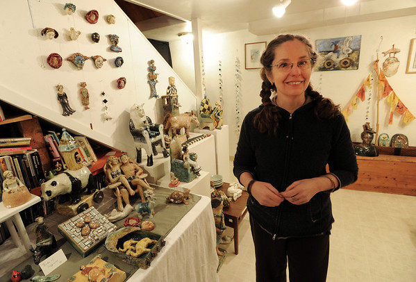 """Caroline Douglas is shown with some examples of her sculptures.<br /> The Open Studios Fall Artists Tour 2012 continues on  Oct. 7, 13, and 14th, from Noon to 6 p.m. each day.<br /> For more photos and a video of open studios, go to  <a href=""""http://www.dailycamera.com"""">http://www.dailycamera.com</a>.<br /> Cliff Grassmick  / October 6, 2012"""