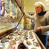 "Nancy Anderson, owner of the SweetBird Studio  near 17th and Pearl, shows a case  of her belt buckles during the open studio tour on Saturday.<br /> The Open Studios Fall Artists Tour 2012 continues on  Oct. 7, 13, and 14th, from Noon to 6 p.m. each day.<br /> For more photos and a video of open studios, go to  <a href=""http://www.dailycamera.com"">http://www.dailycamera.com</a>.<br /> Cliff Grassmick  / October 6, 2012"