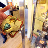 "Nancy Anderson, owner of the SweetBird Studio  near 17th and Pearl, shows one of her belt buckles during the open studio tour on Saturday.<br /> The Open Studios Fall Artists Tour 2012 continues on  Oct. 7, 13, and 14th, from Noon to 6 p.m. each day.<br /> For more photos and a video of open studios, go to  <a href=""http://www.dailycamera.com"">http://www.dailycamera.com</a>.<br /> Cliff Grassmick  / October 6, 2012"