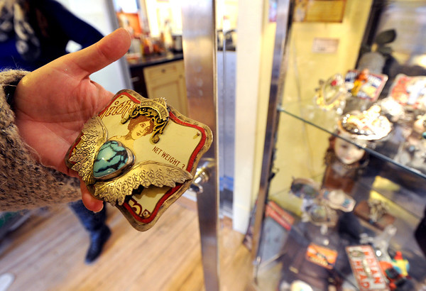 """Nancy Anderson, owner of the SweetBird Studio  near 17th and Pearl, shows one of her belt buckles during the open studio tour on Saturday.<br /> The Open Studios Fall Artists Tour 2012 continues on  Oct. 7, 13, and 14th, from Noon to 6 p.m. each day.<br /> For more photos and a video of open studios, go to  <a href=""""http://www.dailycamera.com"""">http://www.dailycamera.com</a>.<br /> Cliff Grassmick  / October 6, 2012"""