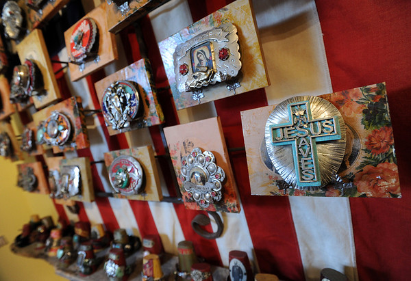 """Examples of Nancy Anderson's belt buckles.<br /> The Open Studios Fall Artists Tour 2012 continues on  Oct. 7, 13, and 14th, from Noon to 6 p.m. each day.<br /> For more photos and a video of open studios, go to  <a href=""""http://www.dailycamera.com"""">http://www.dailycamera.com</a>.<br /> Cliff Grassmick  / October 6, 2012"""