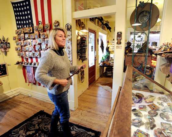 """Nancy Anderson, owner of the SweetBird Studio  near 17th and Pearl, looks over her belt buckles during the open studio tour on Saturday.<br /> The Open Studios Fall Artists Tour 2012 continues on  Oct. 7, 13, and 14th, from Noon to 6 p.m. each day.<br /> For more photos and a video of open studios, go to  <a href=""""http://www.dailycamera.com"""">http://www.dailycamera.com</a>.<br /> Cliff Grassmick  / October 6, 2012"""