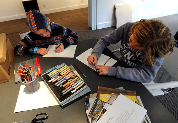 """Nik Stohmeyer, left, and his sister, Liesel, make their own creation at the studio of Sara Stohmeyer on Saturday.<br /> The Open Studios Fall Artists Tour 2012 continues on  Oct. 7, 13, and 14th, from Noon to 6 p.m. each day.<br /> For more photos and a video of open studios, go to  <a href=""""http://www.dailycamera.com"""">http://www.dailycamera.com</a>.<br /> Cliff Grassmick  / October 6, 2012"""