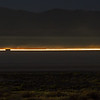17030 Time lapse of vehicles traveling across the playa from the 8-mile access gate to Black Rock City, Burning Man