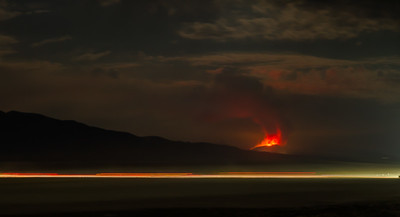 17033 The Tohakum 2 Fire burns south of Empire as vehicles drive on the playa to Black rock City
