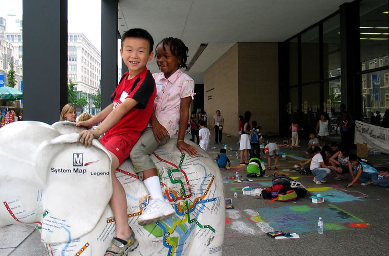 """Young Artists take a break to ride the Metro Elephant  at the """"CHALK 4PEACE"""" Sidewalk Chalk Contest,  Dr. Martin Luther King Jr. Memorial Library, Washington, DC"""