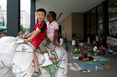 "Young Artists take a break to ride the Metro Elephant  at the ""CHALK 4PEACE"" Sidewalk Chalk Contest,  Dr. Martin Luther King Jr. Memorial Library, Washington, DC"