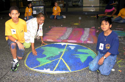 "CHALK4PEACE 2006 Washington, DC Dr. Martin Luther King, Jr. Memorial Library Artists from the Student Council of Woodlawn Elementary in Fairfax, VA ""Big Mama Peace on Earth"" photo: Marielle Mariano"