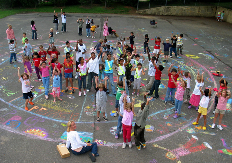 ARLINGTON, VIRGINIA CHALK4PEACE 2006 9/15 Artists and their 40 foot peace symbol Glebe Elementary School The entire school participated; and drawings  stretched for 500 feet!