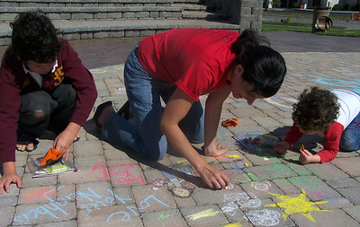 "CHALK4PEACE 2007 Mothers like this are changing the world..."" Centennial Park, Geneva, New York 9/15 photo: Chapin Traugott"