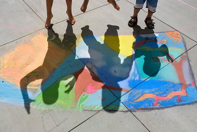 Jumping for joy at  Cragmont Elementary School Berkeley, CA during CHALK4PEACE. photo: Jerry Downs Photography