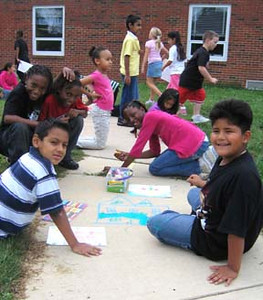 Happy artists painting the planet Woodlawn Elementary School, Alexandria, VA photo: Marielle Mariano