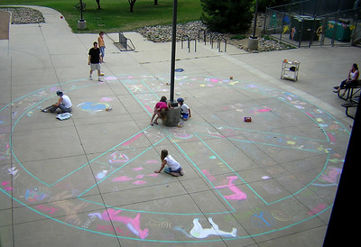 Mr. Wojzcuk painted a a semi-permanent 35' peace symbol for the artists to work with. Superior Elementary School, Louisville, CO CHALK4PEACE School District Invitational Organized by Michael Wojzcuk, Arts Specialist Photo: Mike Wojzcuk