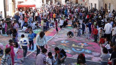 28 classes from the escola de Monte San Giusto took part in Plaza Aldo Moro painting a swath of color through the town  CHALK4PEACE 2010 Clown and Clown Festival 2 Oct. Monte San Giusto, Italy photo: Luciano Bramdimarti
