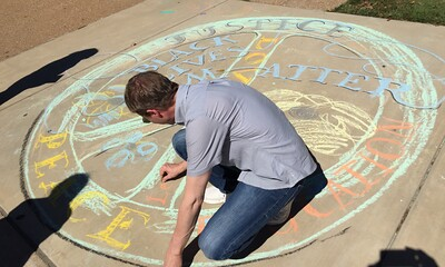 Eric chalkin' it... Drawing FergUSon Together: A Vision of Peace; Sept. 18-19, 2015 Social Justice Summit and Community CHALK4PEACE Celebration   St. Louis Community College, Florissant Valley Ferguson, Missouri