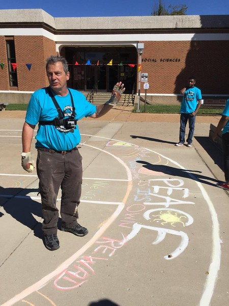 John and William after finishing the peace symbol template Drawing FergUSon Together: A Vision of Peace; Sept. 18-19, 2015 Social Justice Summit and Community CHALK4PEACE Celebration   St. Louis Community College, Florissant Valley Ferguson, Missouri
