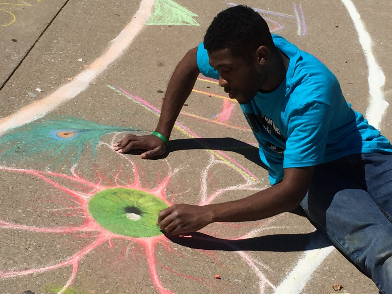 William drawing his vision Drawing FergUSon Together: A Vision of Peace; Sept. 18-19, 2015 Social Justice Summit and Community CHALK4PEACE Celebration   St. Louis Community College, Florissant Valley Ferguson, Missouri