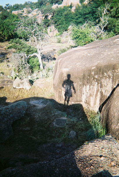 caught my shadow while bouldering at Enchanted Rock State Park (Fredericksberg Texas)...a great playground of monolithic pink granite...