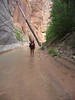 """...hiker taking a break in zion national park's """"The Narrows""""...hot dessert air and cold, cold, cold virgin river hike...a spectacular sight to behold is this hike.."""
