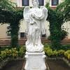 Statue of an angel guarding Capilla Santa Ana's Labyrinth