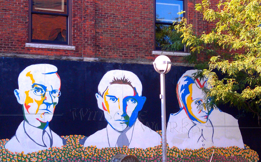 Mural faces on building wall in Ann Arbor, MI