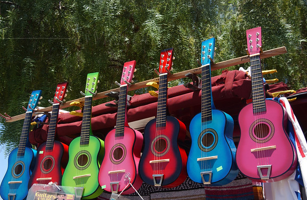 Kids' guitars hanging in San Diego Olde Towne shop