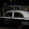 Night scene at Kemah; classic police car