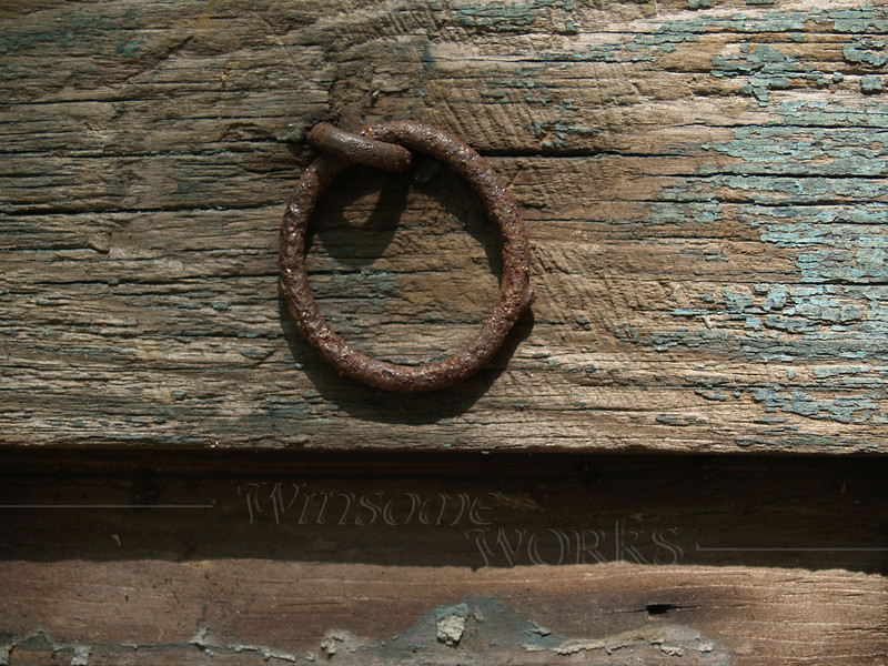 Old hardware on weathered board
