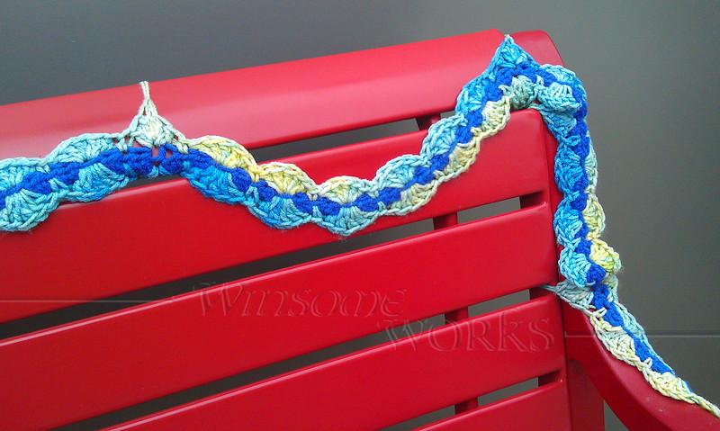 Knit bombing on a bench in Art Alley - Goshen, IN