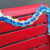 Knit bombing on a bench in Art Alley - Goshen, IN