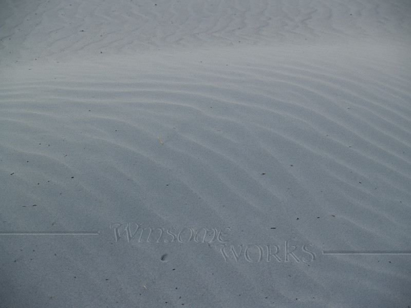 Light & shadow patterns on dunes at dusk