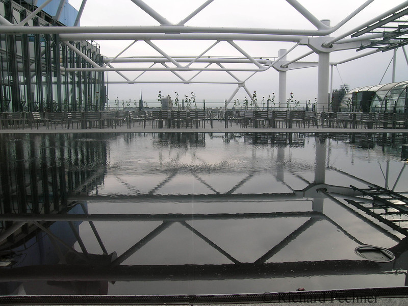 Trusses, reflecting pond and outdoor cafe